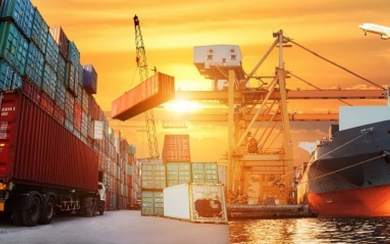 View of container yard with sunset background