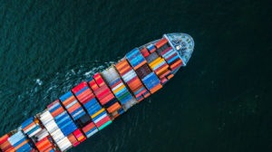 Cargo ship in import export and business logistic, Logistic and transportation of International Container Cargo ship in the open sea, Aerial shot from drone