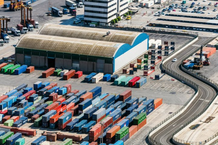 Aerial view of Containers and warehouse in Port De Barcelona (Catalonia), Spain.
