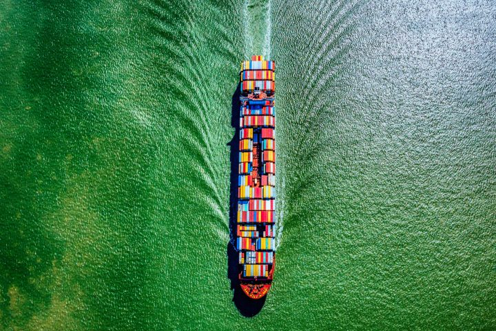 Directly above a fully loaded cargo ship pulling into port sailing into Galveston Bay, Texas shot from an altitude of about 1500 feet during a helicopter photo flight.