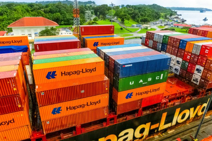Panama Canal, Panama - December 7, 2019: Hapag-Lloyd cargo ship entering the Miraflores Locks in the Panama Canal, in Panama