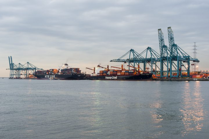 Anwerp, Belgium - September 16, 2011: Port of Antwerp in the twilight with containers and cranes