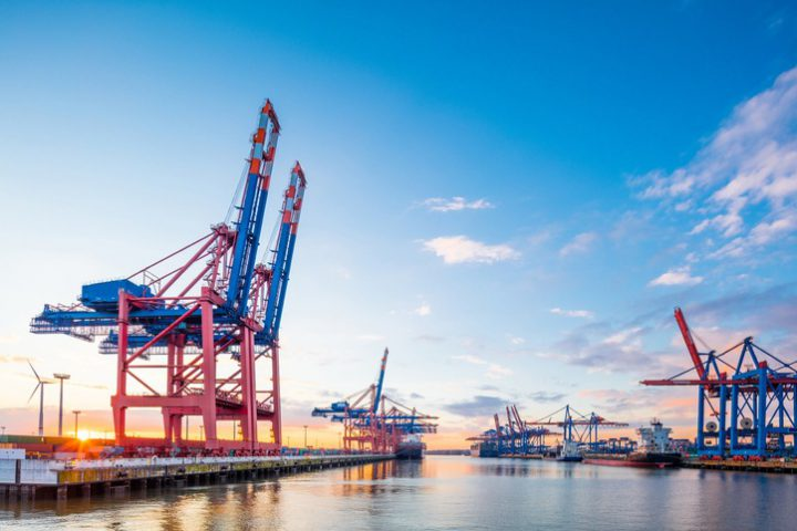 One of the big container terminals in Hamburg harbour. Big cranes are waiting to load and unload the giant container ships. Giant 50 Mpx image, taken with Canon EOS 5Ds and Tilt Shift 17mm 4,0.