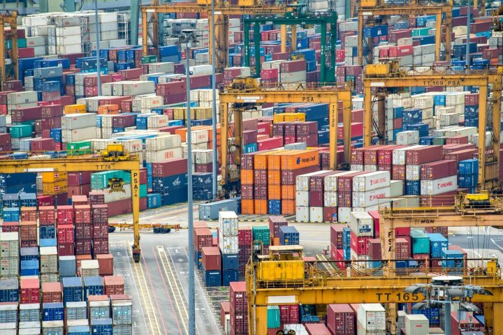 Singapore, Singapore - May 7, 2015: Piles of containers in the harbor of Singapore, the busiest asian commercial port