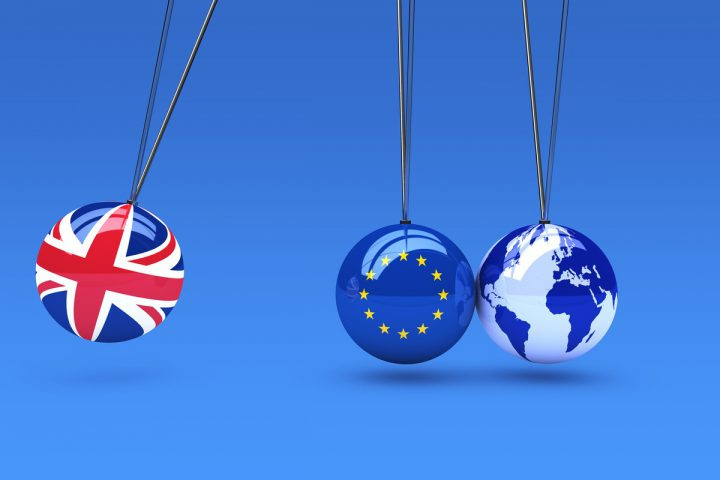 Brexit global business consequences concept with Union Jack, EU flag on balls and world map globe 3D illustration.