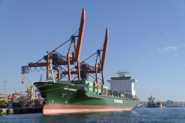 Istanbul, Turkey - November 3, 2016: Container ship Uni-Assent, which is belongs to Evergreen, at The Port of Haydarpasa at Istanbul was unloading it's cargo in a sunny day with huge container cranes.