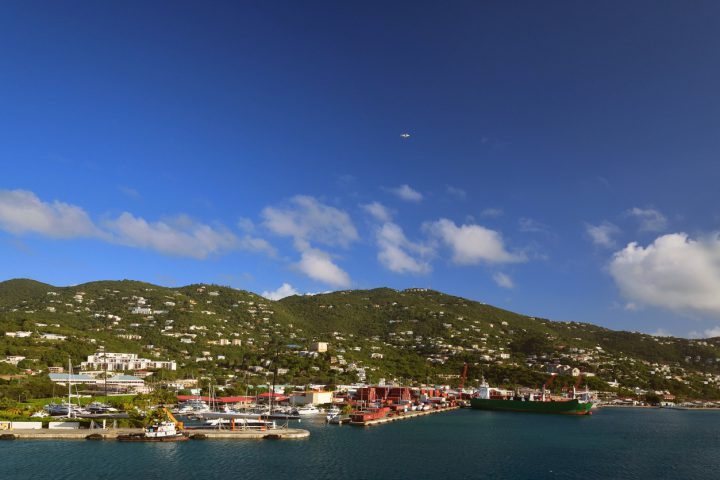 Resort condos dot the hillside above the Charlotte Amalie industrial harbor in Bay de Grigri on a bright clear morning as a cruise ship brings tourist into the US Virgin Island tourist mecca