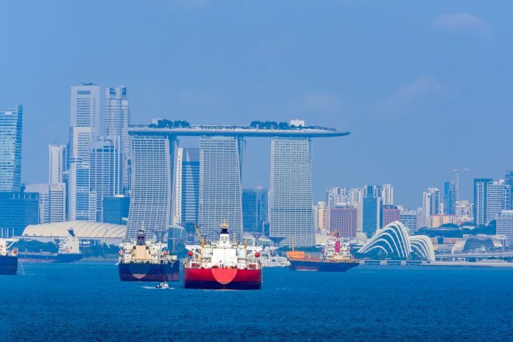 Various cargo ships waiting to load and unload in the harbour at the busiest port of Singapore