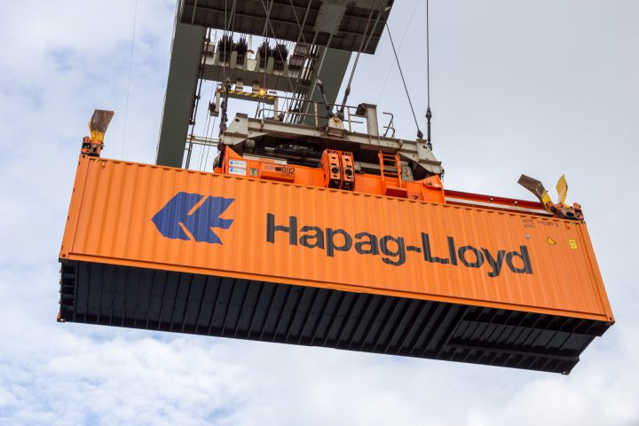 ROTTERDAM - SEP 6, 2015: Crane operator picking up a Hapag-Lloyd sea container in the Port of Rotterdam.
