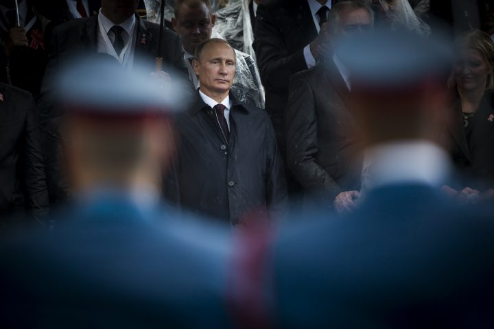 Belgrade, Serbia  - October 16, 2014: Russian President seen through the soldiers during the military parade